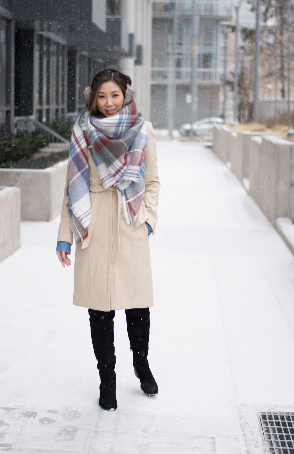 5e957b0efea10 Cosy Winter OOTD streetstyle look: plaid scarf and long wool coat, fur ear  muffs