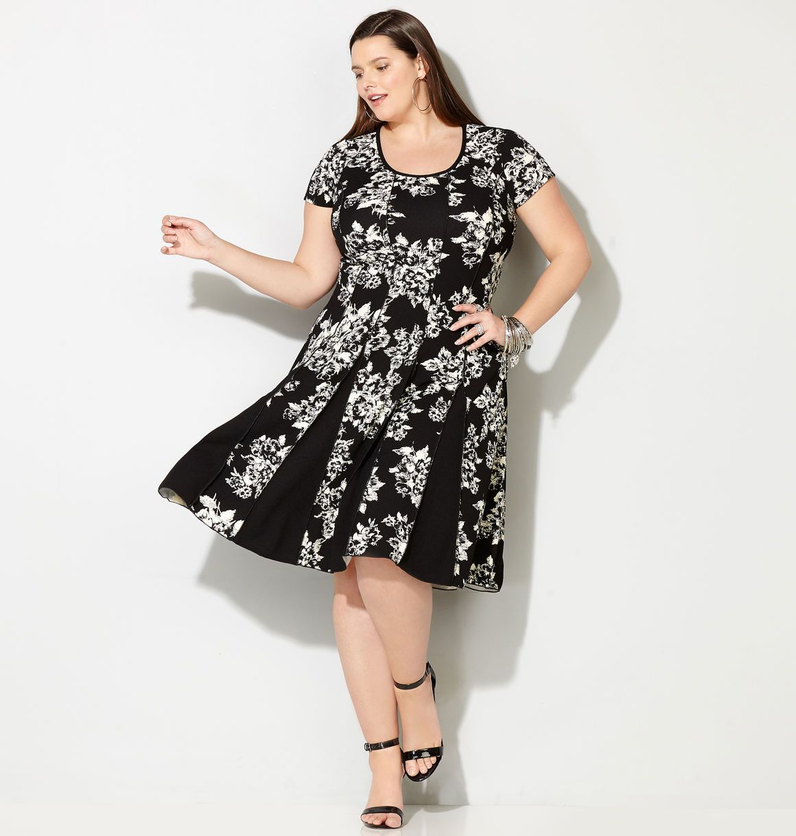 9b9fdf2741 Shop flattering plus size dresses in sizes 14-32 like the Contrast Floral  Seamed Fit and Flare Dress available online at avenue.com. Avenue Store