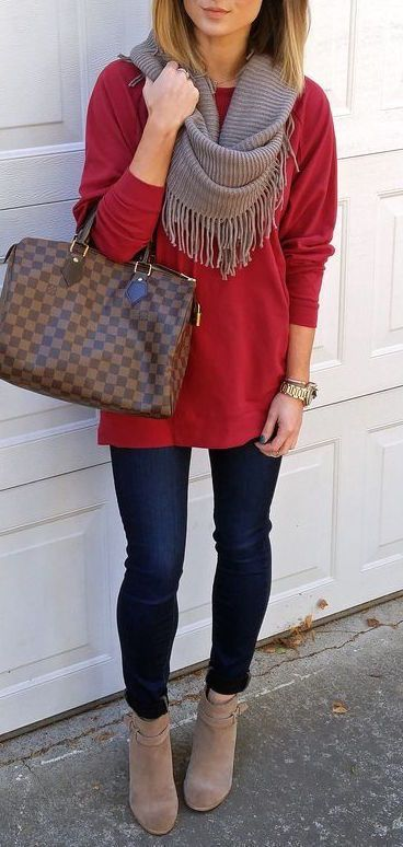 Red top, blue jeans with taupe scarf and booties.