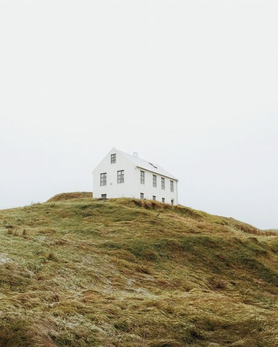 W H I T E With Images Landscaping On A Hill Beautiful Places House On A Hill