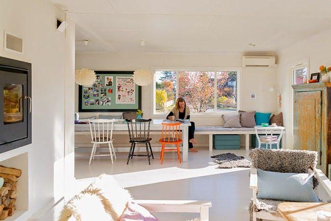 Un salón-comedor nórdico con toques de TURQUESA Y NARANJA! | Decorar tu casa es facilisimo.com