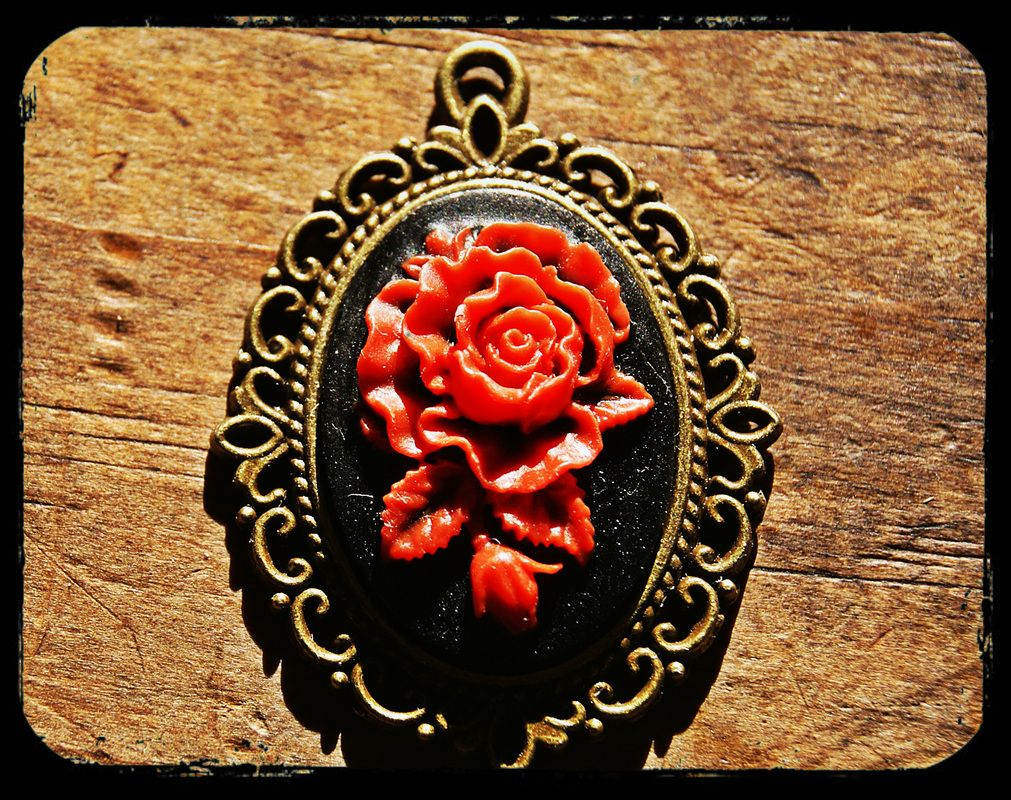 A striking red rose set against a black backdrop in this cameo necklace. $20- --Handmade by me (Rebecca Patrick-Howard) Follow the link for order info.