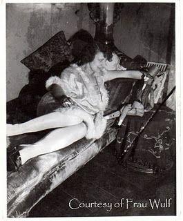 This German photo of a lady smoking and a cool boudoir doll is marked Reinhold Schaefer, Berlin-Niederschoenhausen.