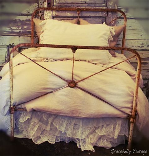 Antique Iron Twin Bed With Lace And Ruffled Skirt Iron Bed Antique Iron Beds Bed