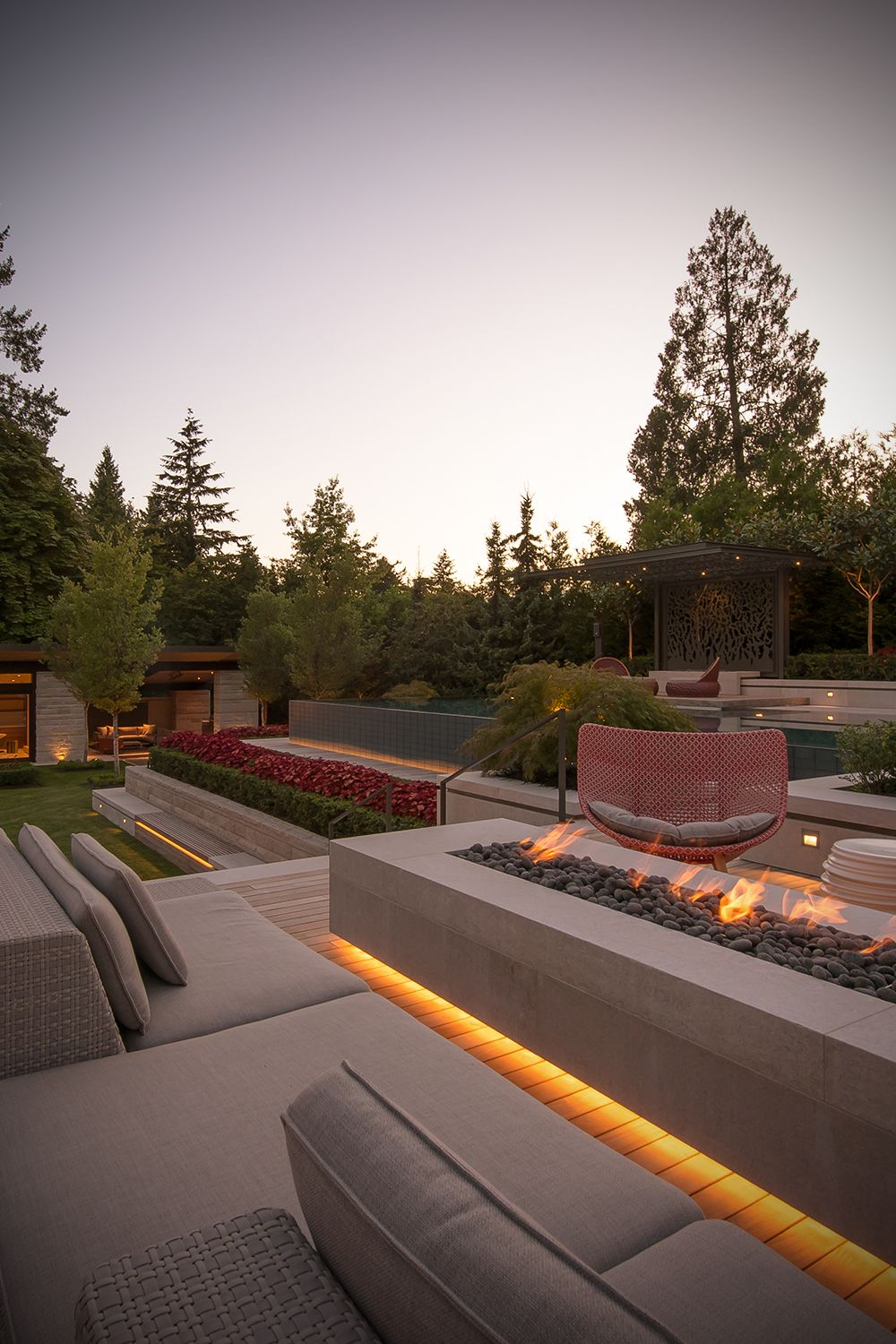 Pool guest house outdoor fireplace stone patio modern rustic luxury design