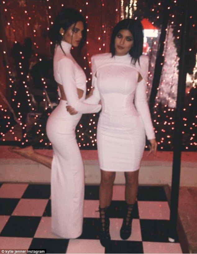 d6f97eb5f2ed Healthy competition  Kendall and Kylie Jenner got slightly competitive in  matching white outfits for mom Kris Jenner s Christmas Eve party