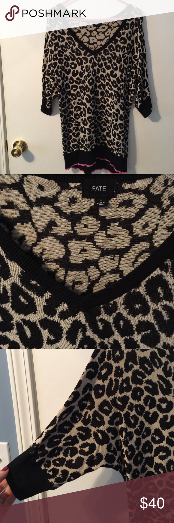 Stitch Fix Fate Leopard print Dolman tunic/sweater Worn maybe 3 times. Has adorable bright pink trim around the bottom. Is v-neck with Dolman sleeves. Long enough to cover the booty! Looks great over leggings and with pink accessories. Fate Sweaters V-Necks