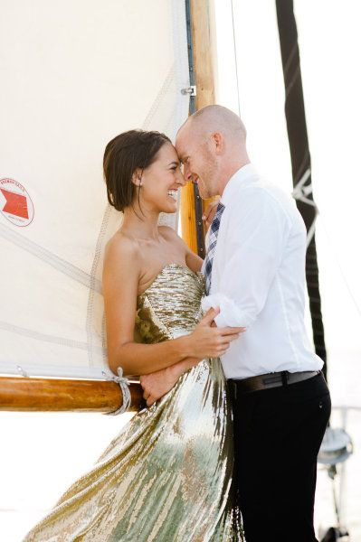 Gold dress, sailboat, gorgeous couple= LOVE.  Style Me Pretty | Gallery