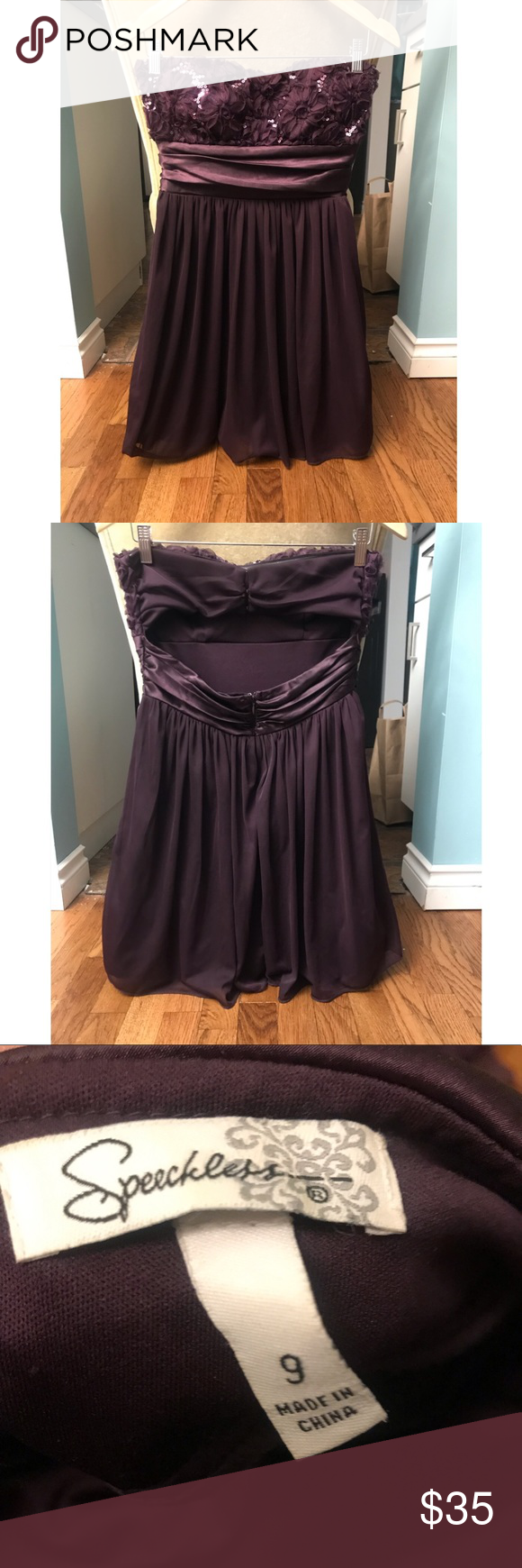 Dark Purple Cocktail Dress Purple short cocktail dress with flower and sequin detail. Clasps in perfect condition. Worn a couple times. Super cute! Comfortable, strappy, and somewhat backless. Speechless Dresses Strapless #backlesscocktaildress