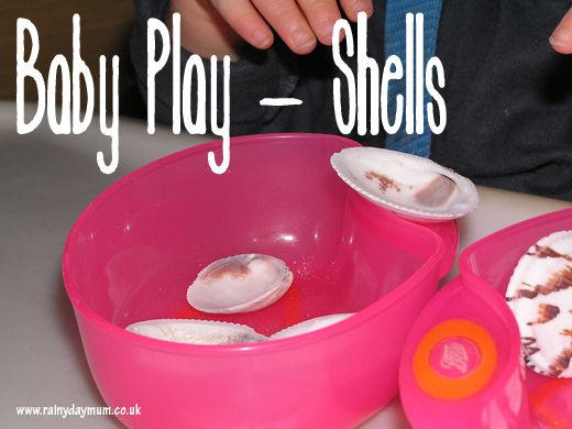 Baby montesorri inspired play - shells, looking at transferring and different textures