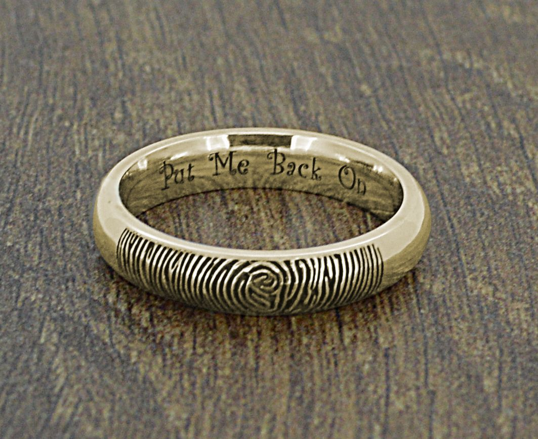 Beautiful Gold Fingerprint Wedding Ring with Alice in Wonderland style engraved message saying Put Me