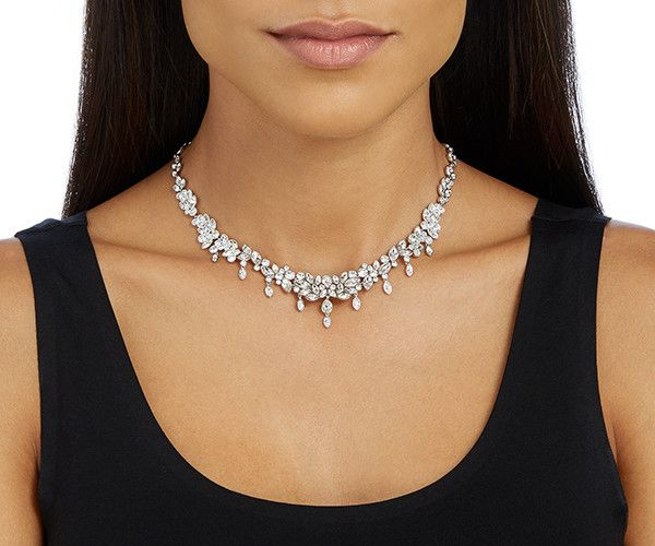 6c88184c3bf A glamorous rhodium-plated necklace. This romantic design impresses with a  multitude of shimmering clear crystals and dangling elements. Thanks to.