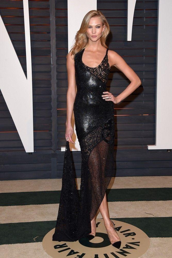 Karlie Kloss wearing Repossi Berbre Multipiercing Earrings, Repossi Berbere Ring, Atelier Versace Spring 2015 Dress and Gianvito Rossi Patent Leather Flats