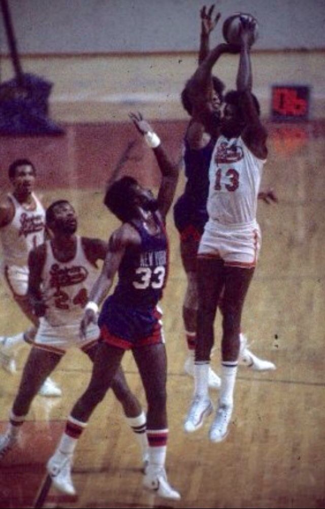 0eb76b8a0f9 Moses Malone (13)   Marvin Barnes (24) of St Louis Spirits v NY Nets ...