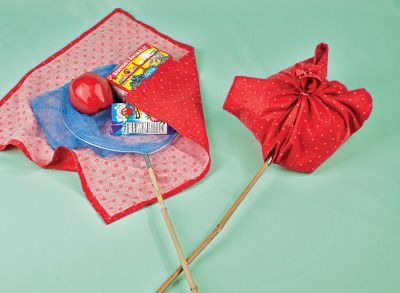 "A butterfly catcher with an apple, a juice box, and animal crackers says ""happy trails"" to all. Wrap it in snazzy fabric."