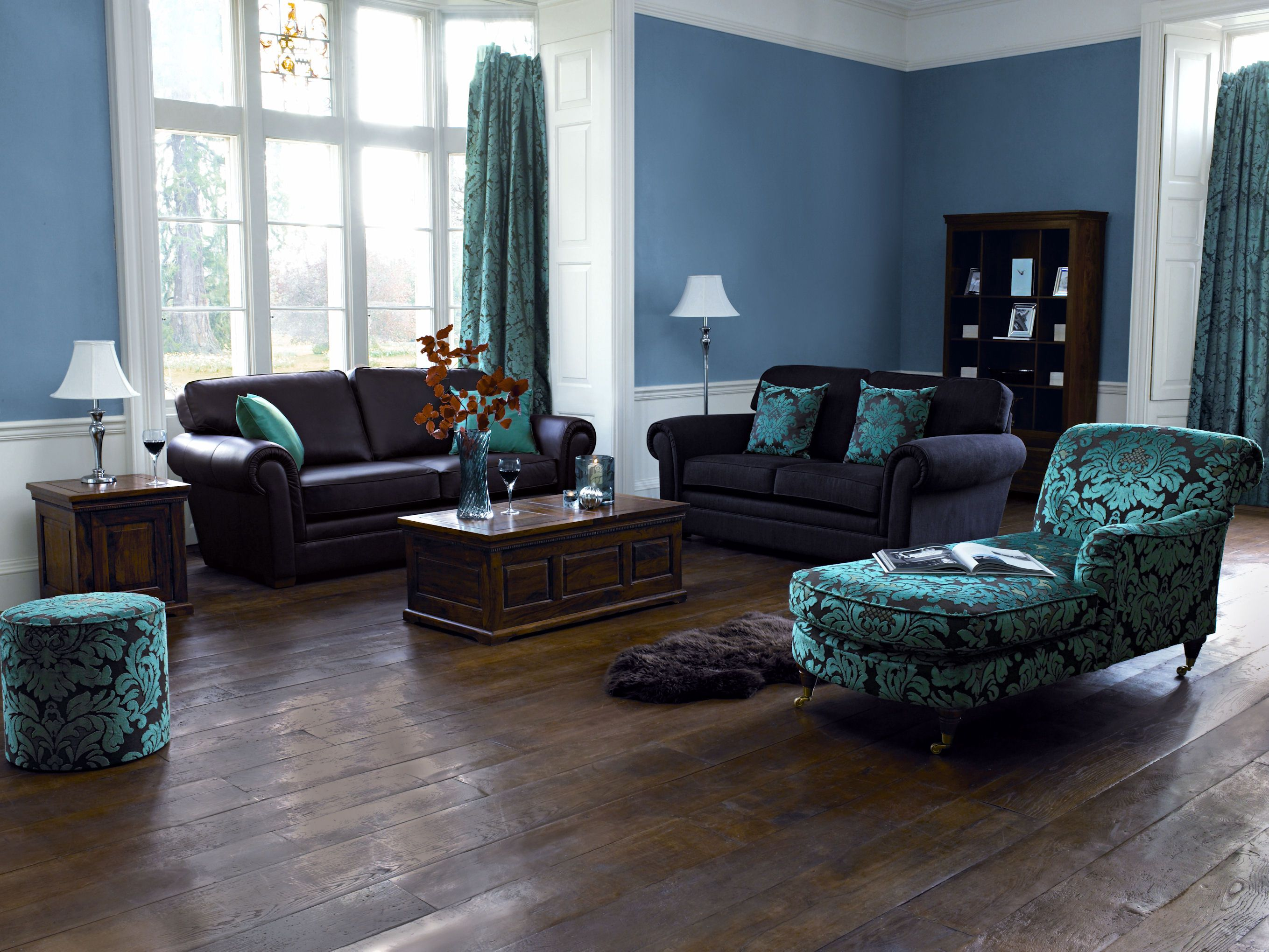 Blue living room ideas with various theme brown leather sofa and blue floral pillow near classic standing lamp also table lamp on dark blue living room