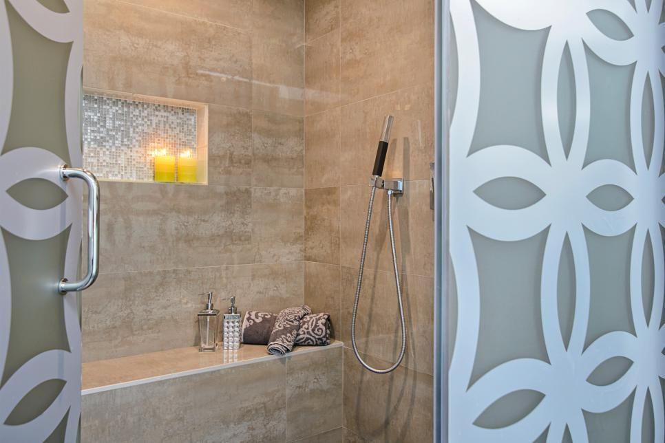 Inside this lovely shower, an inset shelf makes a good spot for ...