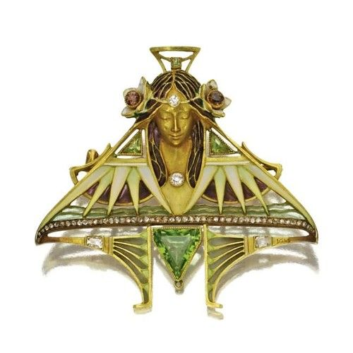 Lucien Gautrait  Art nouveau gem-set brooch, 1900  18k gold, peridot, diamond and enamel Art Nouveau  .  In Egyptian taste, depicting the head of a contemplative maiden with floral headdress emerging from a modified triangular motif of stylized lotus blossoms, decorated with plique-à-jour and cloisonné enamel, 3 triangular peridots, numerous rose-cut diamonds, and 7 old European-cut, tapered baguette and square-cut diamonds, including three of brown and yellow hue, signed L. Gautrait
