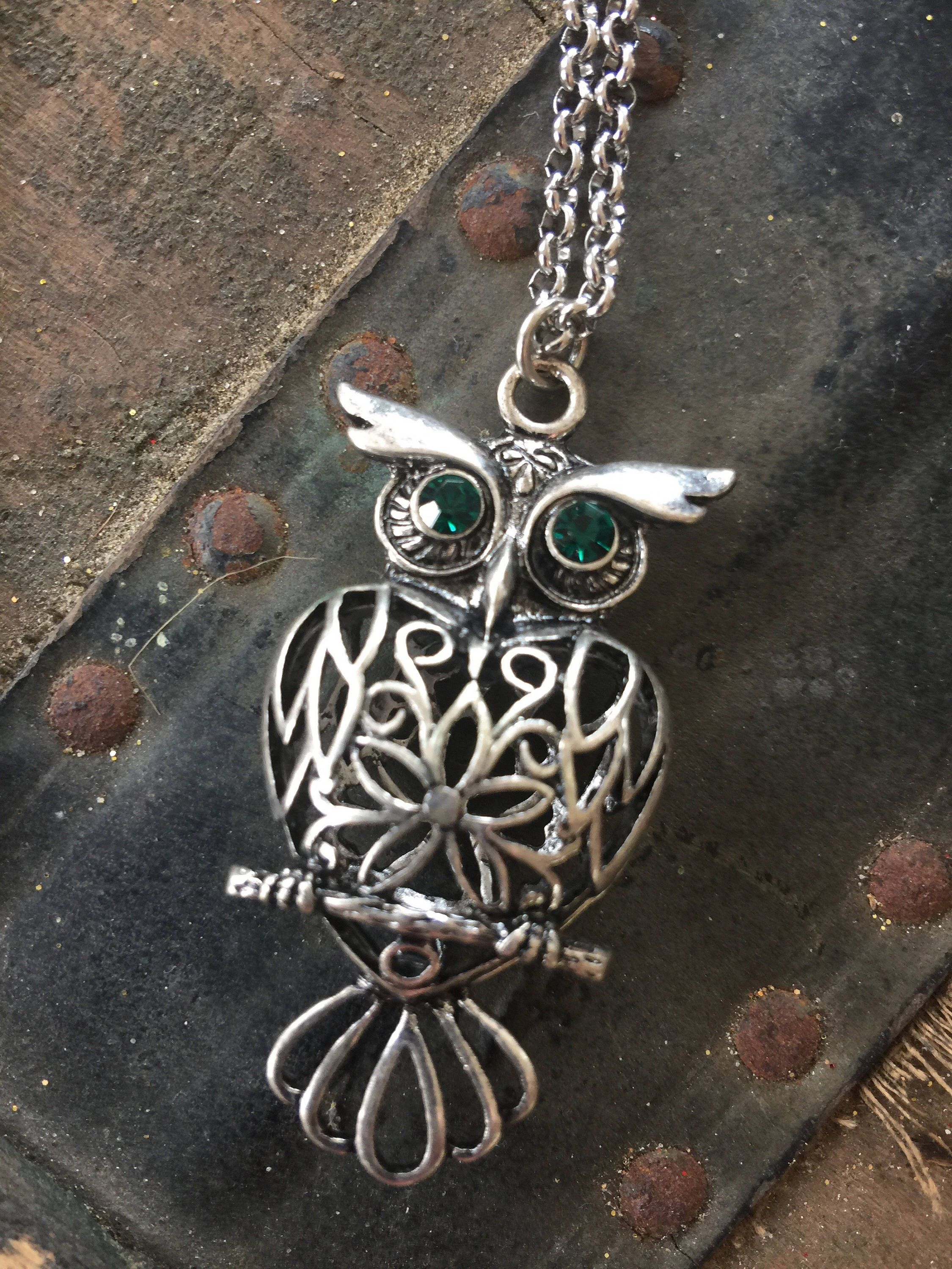 A personal favorite from my Etsy shop https://www.etsy.com/listing/527978377/silver-owl-pendant-36-necklace