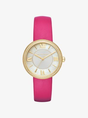 Simple in design and rich in detail, our Courtney watch is a sophisticated timepiece for your everyday. The smooth leather band is complemented by a gold-tone bezel lined in sparkling pavé crystals while gilded Roman numeral indexes and a mother-of-pearl face complete this feminine-luxe accessory with added shine.