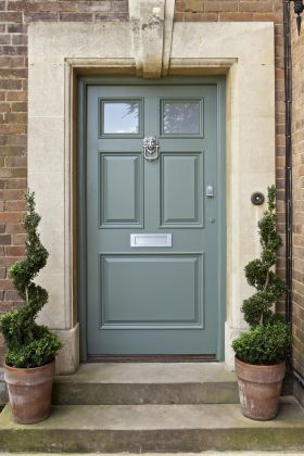Sage Green Door With A House That Is Shades Of Tan And Beige Painted Front Doors Green Front Doors Front Door Paint Colors