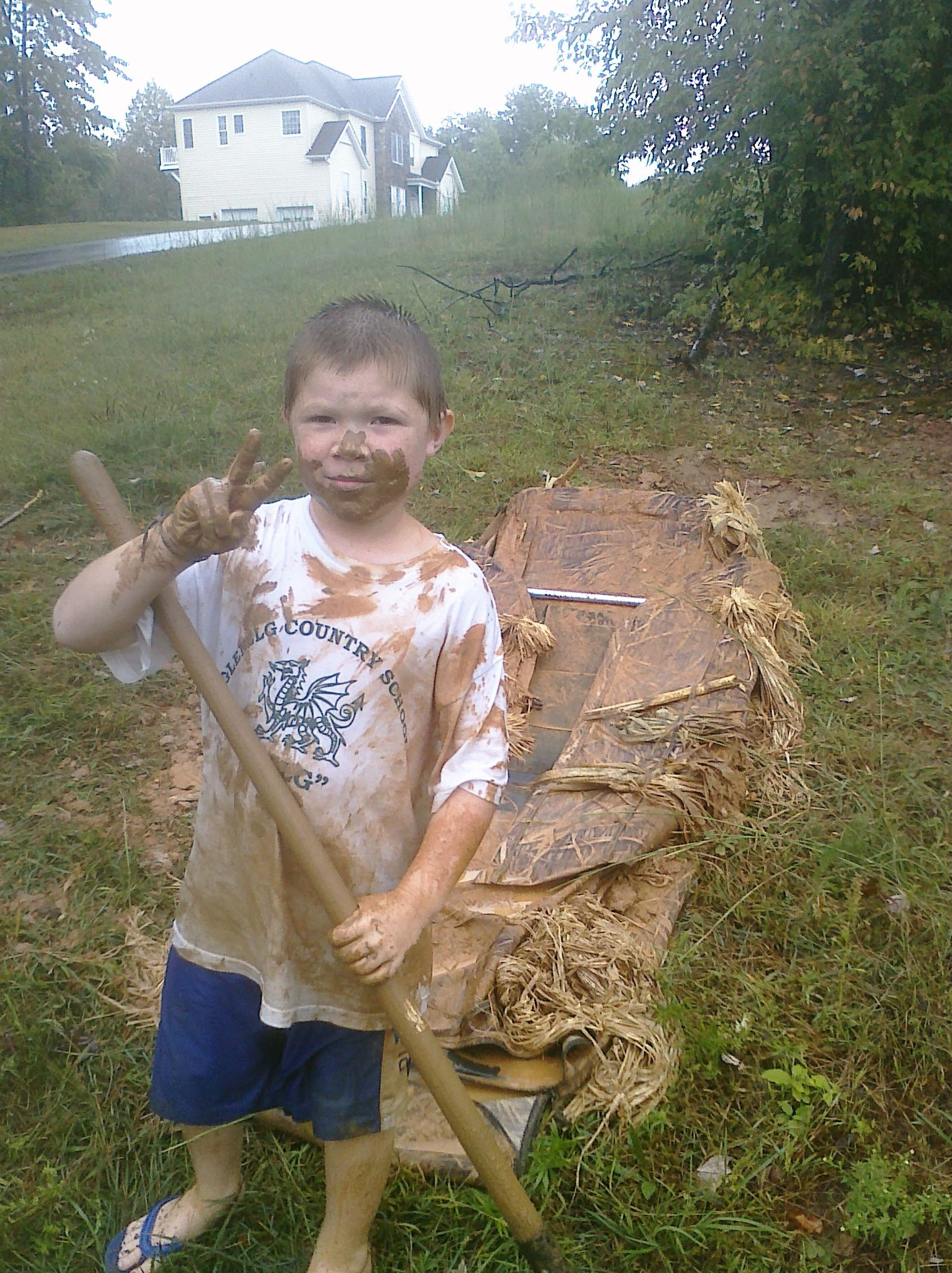 Aidan taking advantage of the rain and mud so we could
