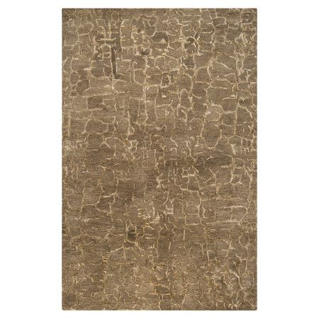 Hand-tufted New Zealand wool rug with an abstract motif.   Product: RugConstruction Material: New Zealand wool