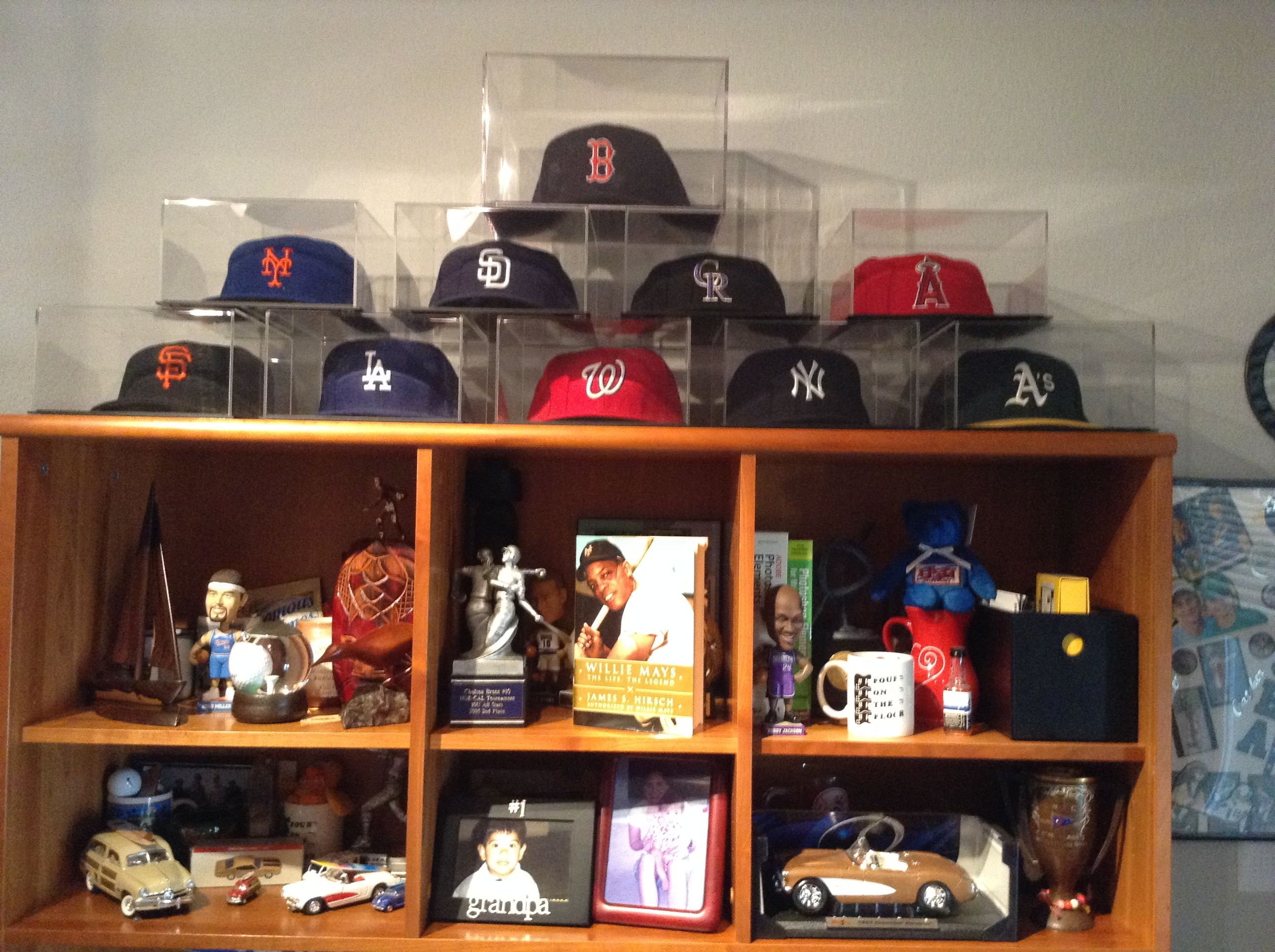 My husband decided that we would put all of his caps in individual cubes.  Now we can add tickets or pictures when we go to the stadiums.  We are going to see if a local plastic mfg. can make the smaller boxes.  The Boston Red Sox hat is in a larger box.