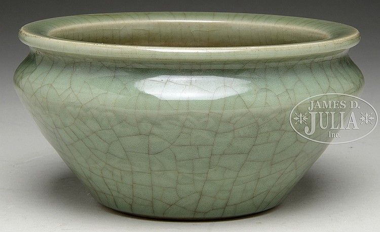 Longquan Kiln Celadon Glazed Censer. Southern Song Dynasty period, China. Of compressed globular form, the Longquan kiln censer glazed in dark celadon and crackle pattern on the exterior, with partially glazed interior. D: 6-3/4 in H: 3-3/8 in