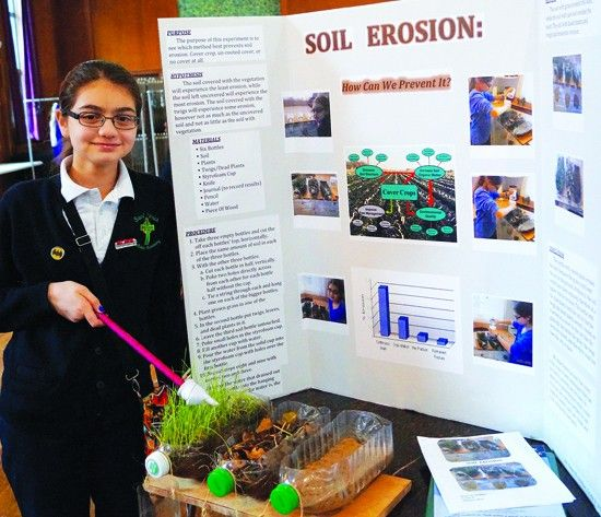 Eighth Grader Helen El Achkar Shows Off Her Project On Soil Erosion