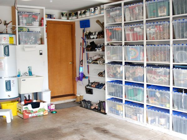 Ample storage in the garage  I love the shelving and the plastic  containers  Store. Ample storage in the garage  I love the shelving and the plastic