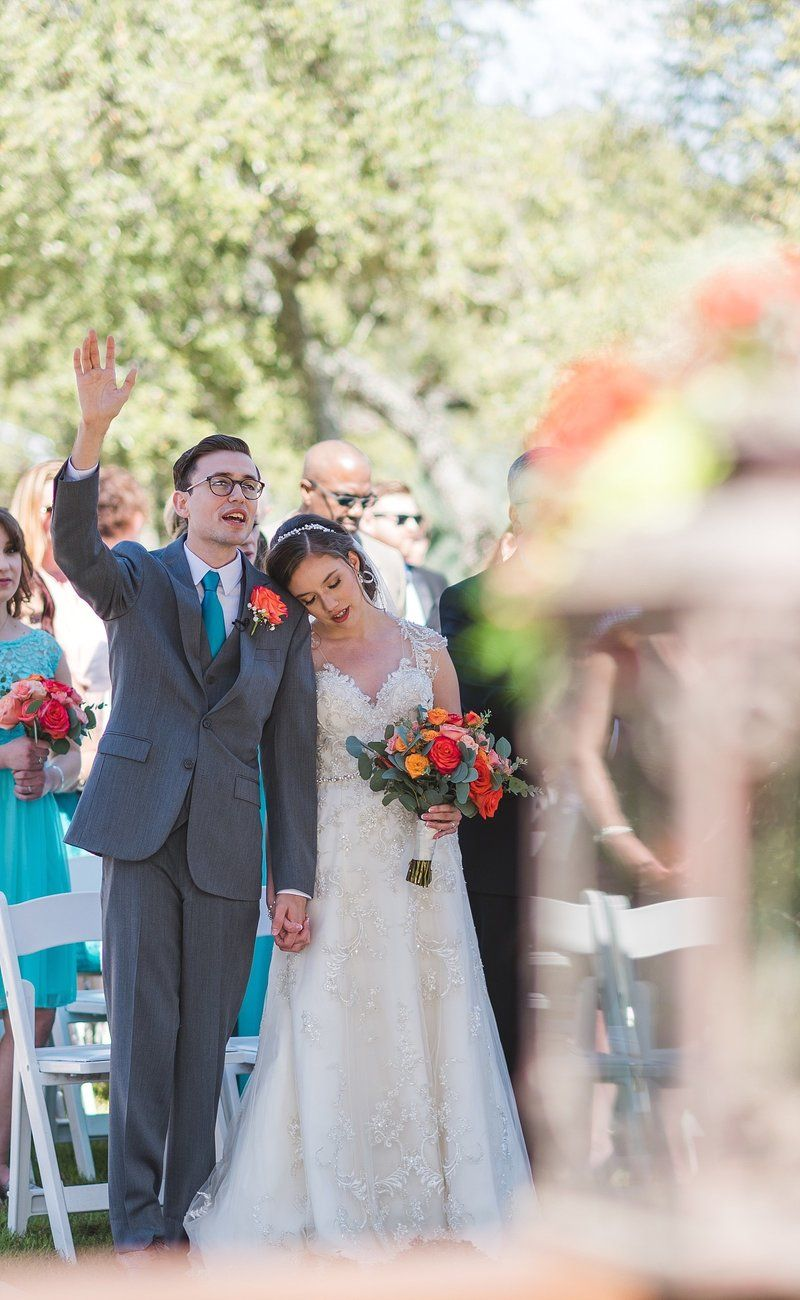 Bride and groom singing worship songs after the ceremony at their ...