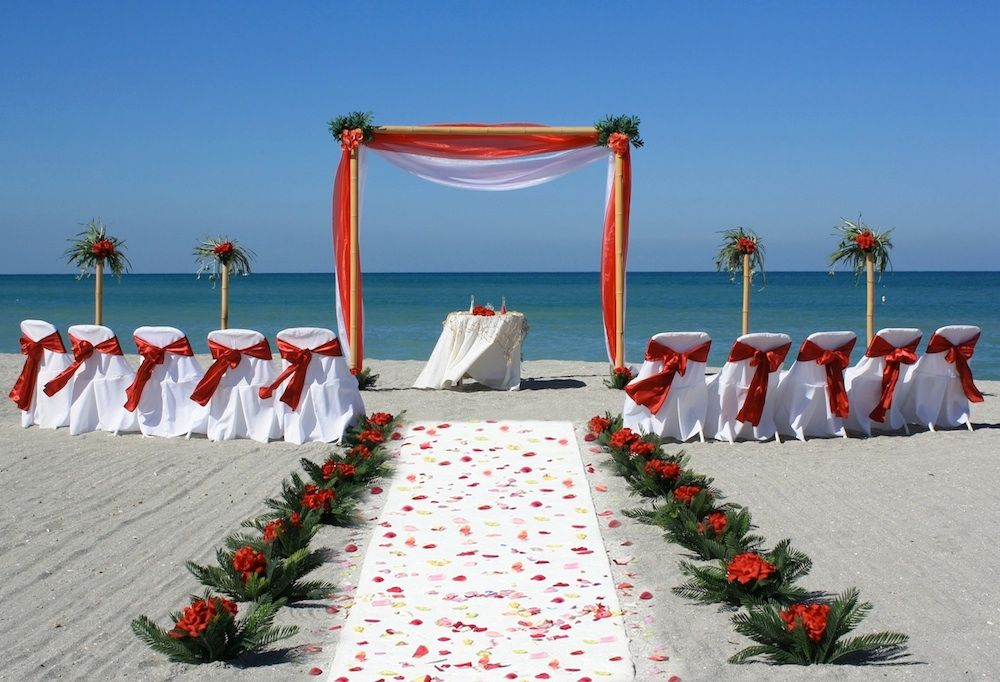 Red Fabric On White Covered Chairs.
