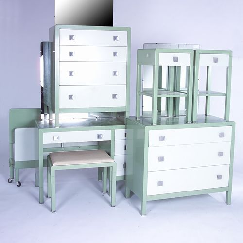 NORMAN BEL GEDDES/SIMMONS Enameled Metal Bedroom Furniture Suite Consisting  Of A Vanity And Two Chests, All With Chrome Pulls And Attached Mirror; ...