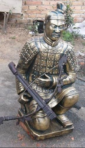 imitation brass color kneeling archer with weapon