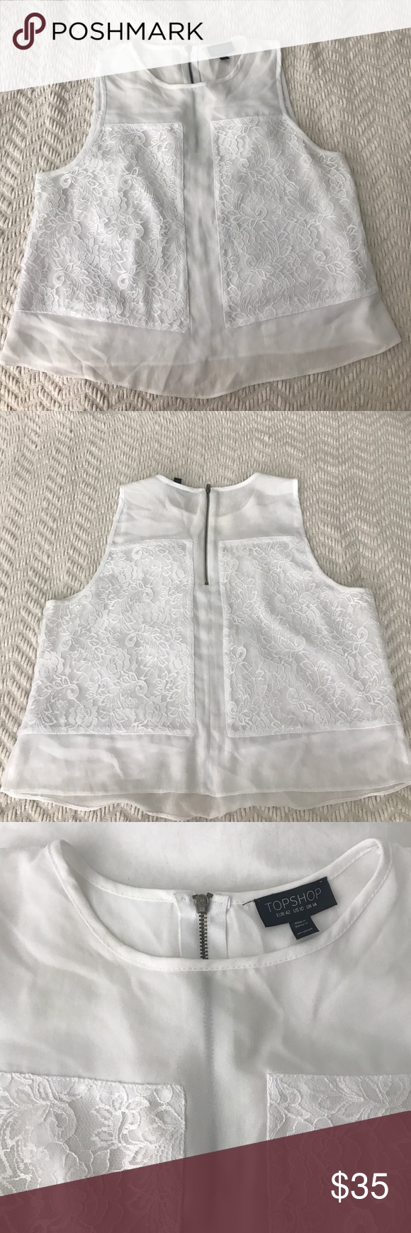 Topshop lace cropped top Topshop laced panel slightly cropped top. US size 10. Somewhat sheer top with lace panel design in the front and back. Half zipper closure on back. 100% polyester. Worn twice and washed, in good condition. Perfect for dressing up or worn casually! Topshop Tops Crop Tops