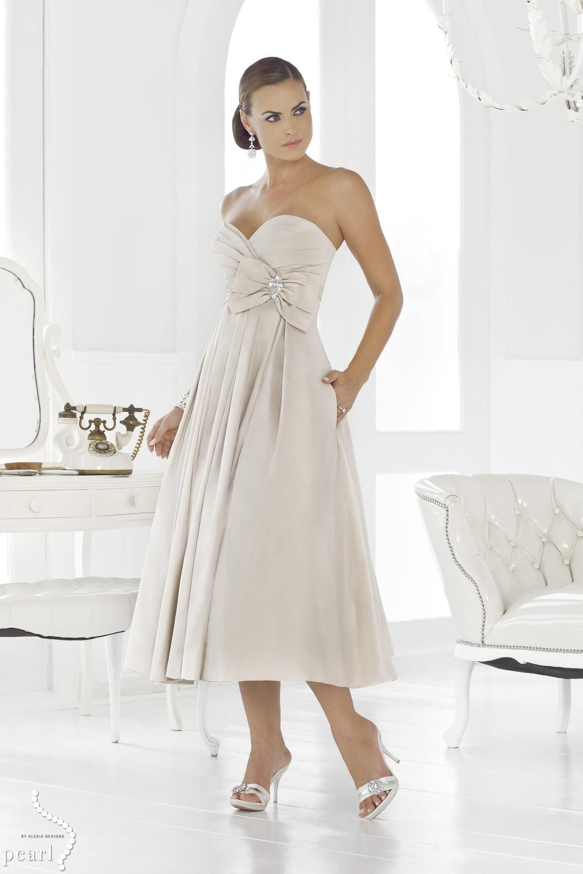 Style *1021 IRIS  » Wedding Dresses » Pearl Continuations Collection » Pearl Bridals » Available Colours : Champagne, Ivory, White (Shown asymetrical Pleated bodice with large Bow & side seam Pockets at skirt)