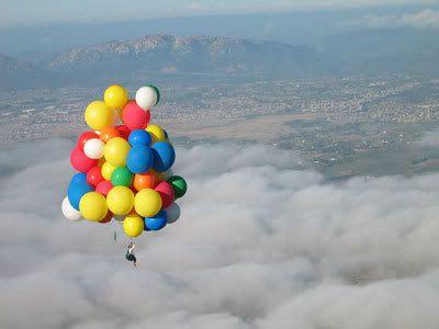Kid hanging on a balloon