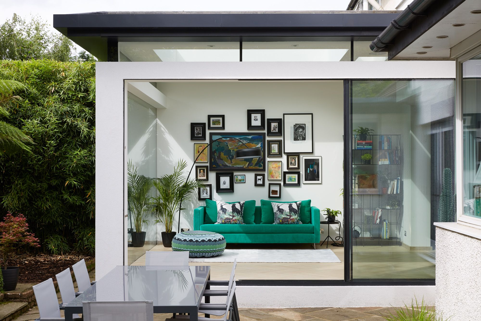 Garden room extension with a picture frame glass window for Modern garden room extensions