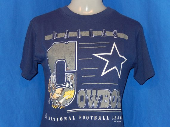 7ac6d7399 80s Dallas Cowboys Jack Davis Cartoon Navy Blue Vintage t-shirt Youth Medium