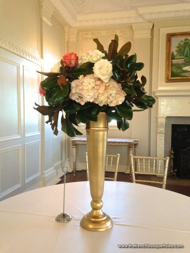 Tall gold vase centerpiece of blush hydrangea white and