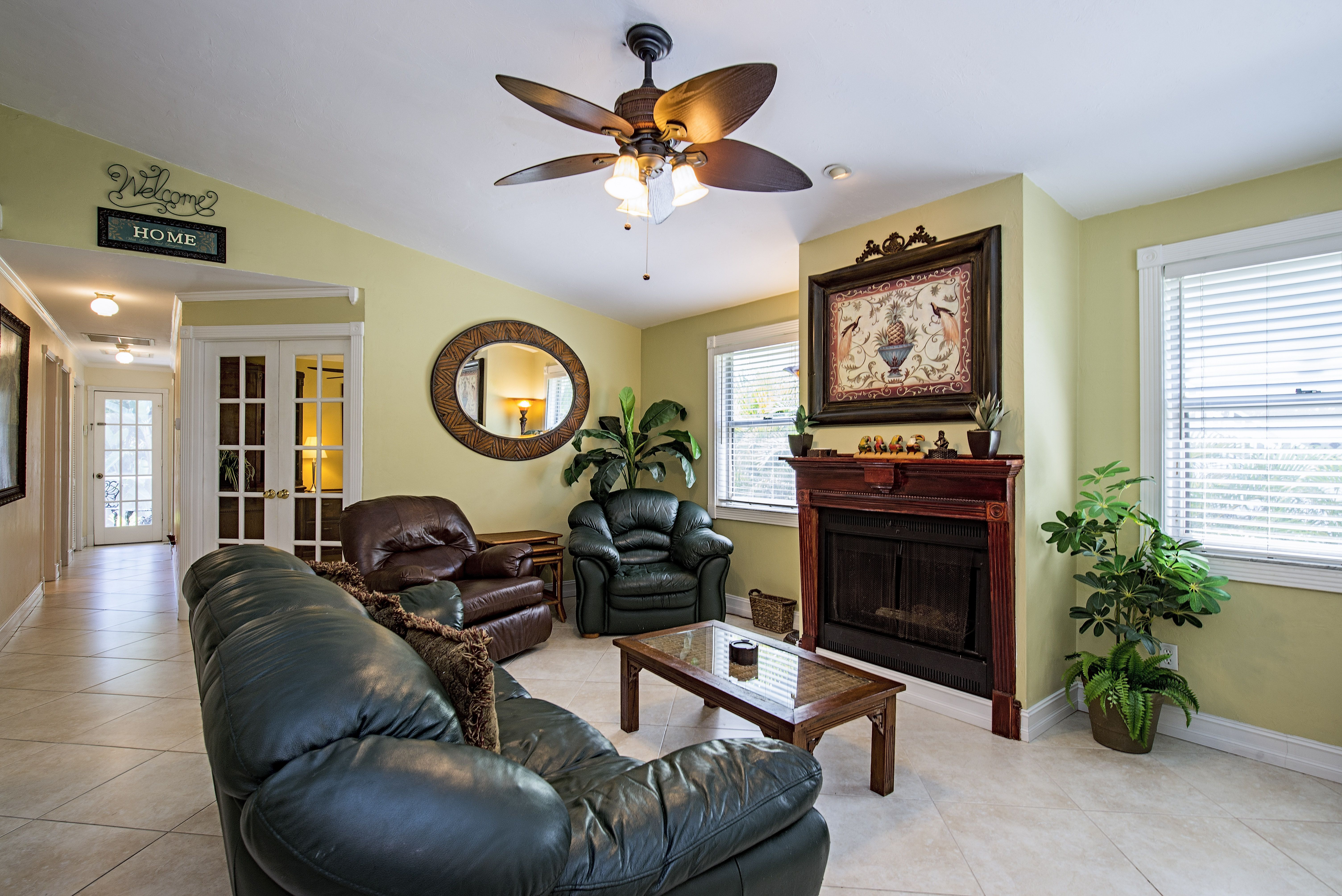 Open floor plan with ambient lighting, fireplace, vaulted