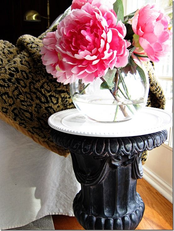 Urn repurposed as a table for porch