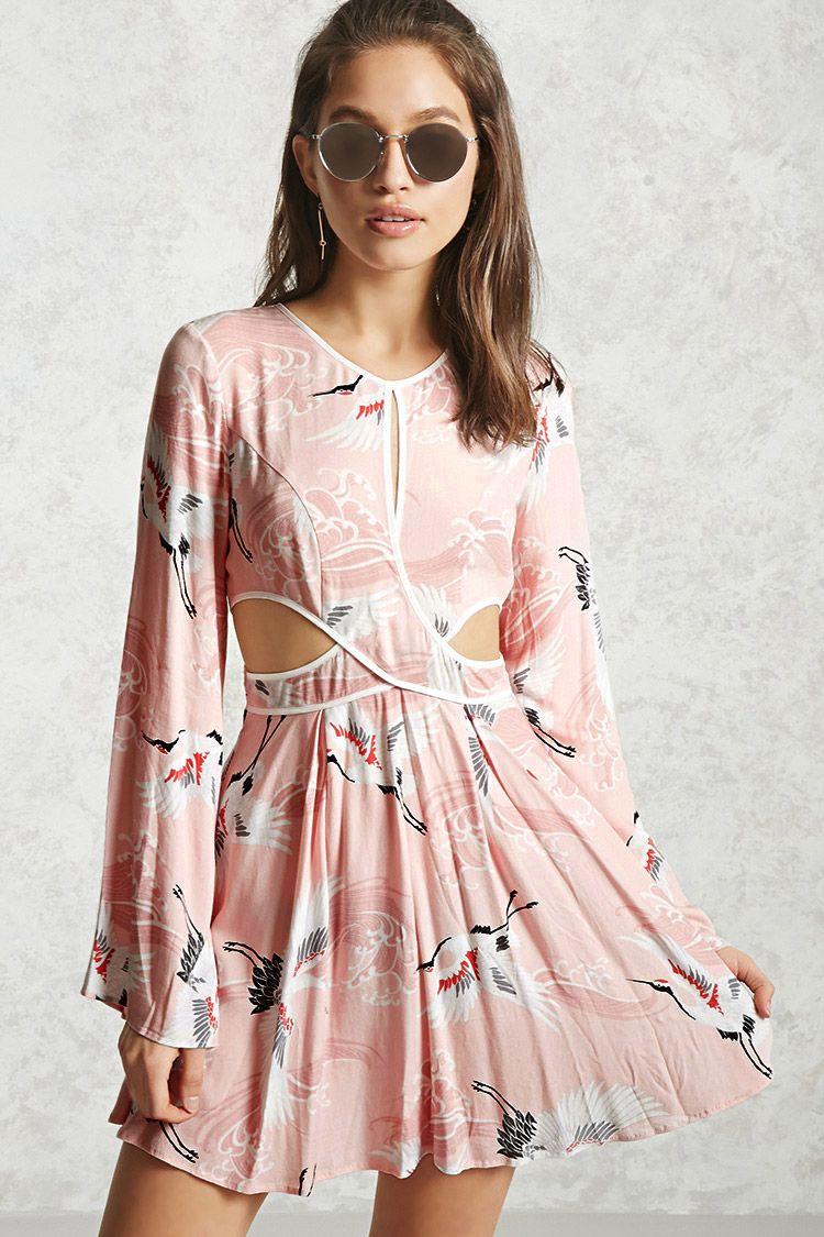 A textured woven mini dress featuring an ocean wave and crane print