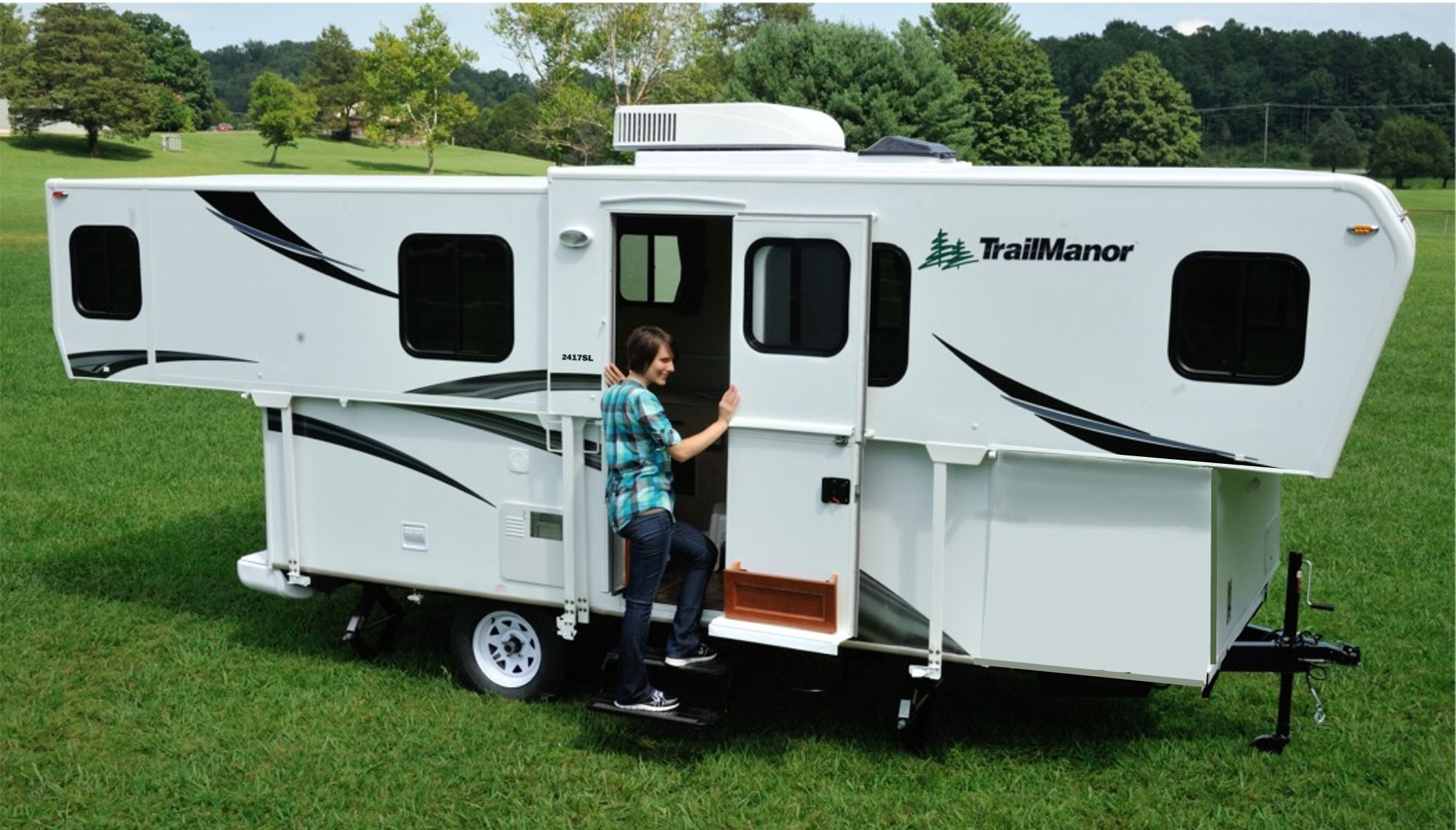 TRAILMANOR 2417KS with slide out living room. Campers