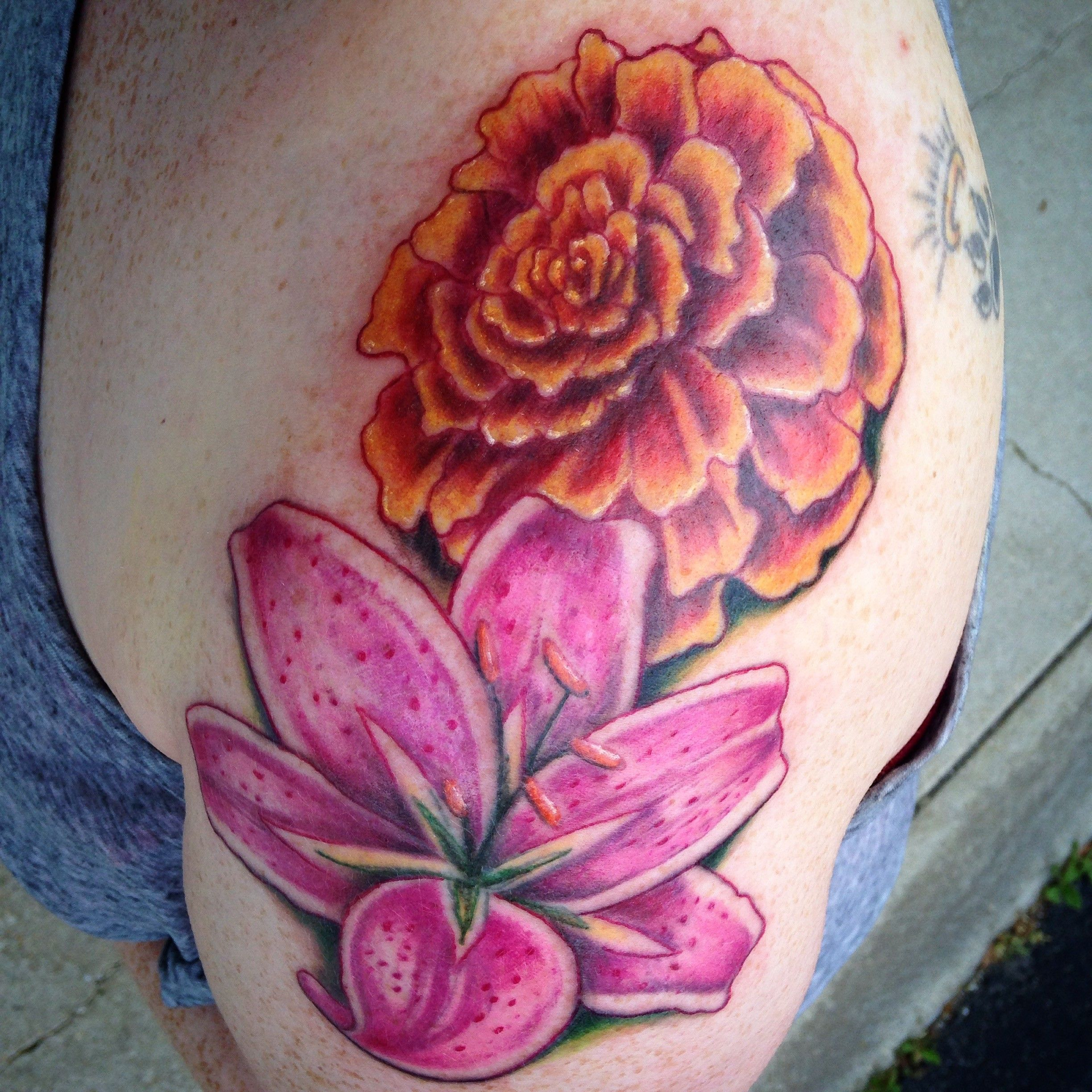 Marigold and lily flower tattoo by diane lange at moonlight tattoo marigold and lily flower tattoo by diane lange at moonlight tattoo seaville nj izmirmasajfo