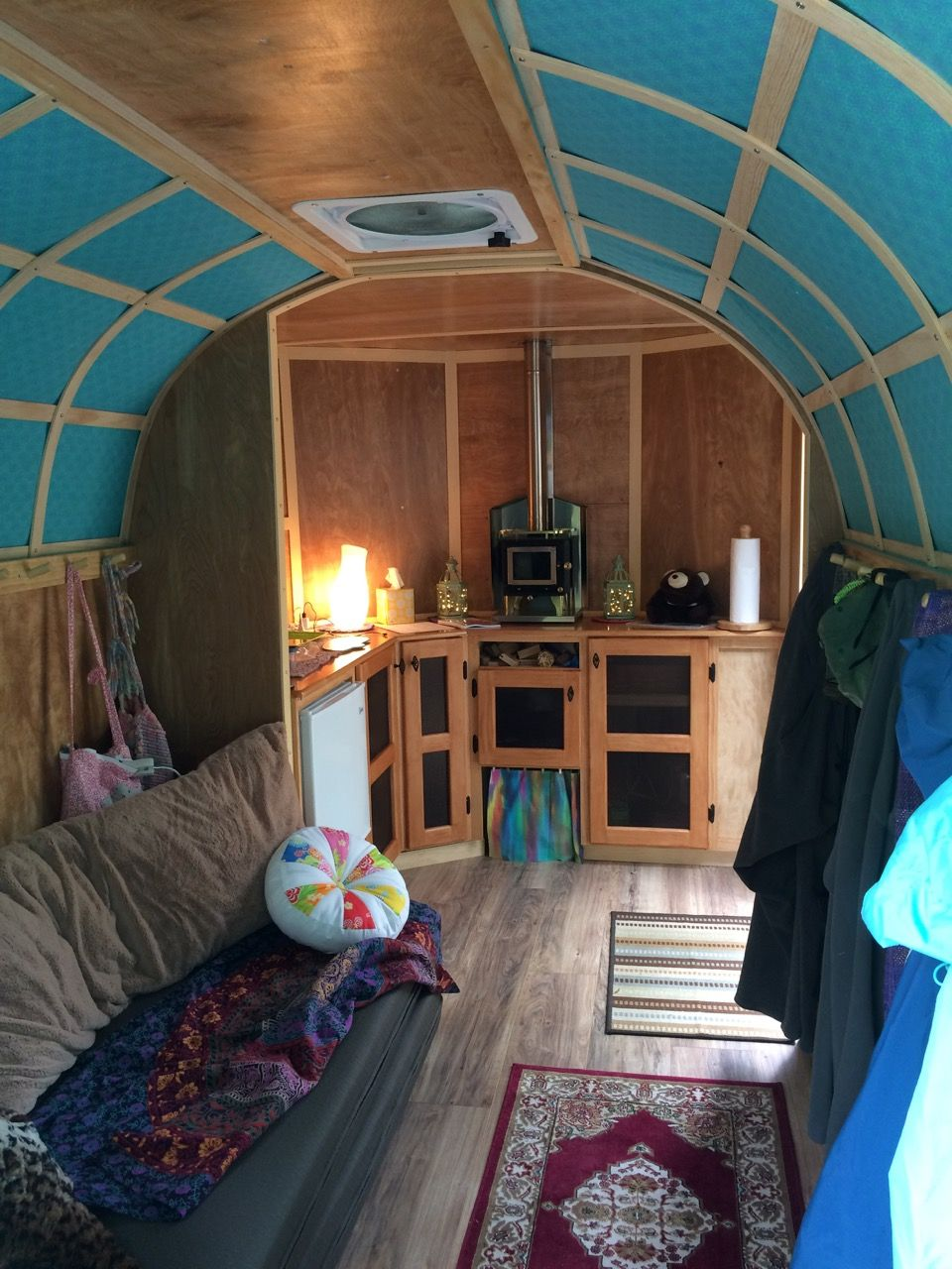 6x12 cargo trailer camper conversion couch on left opens into a