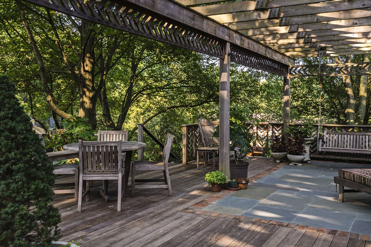 Deck and patio combination. Bluestone paving outlined with ...