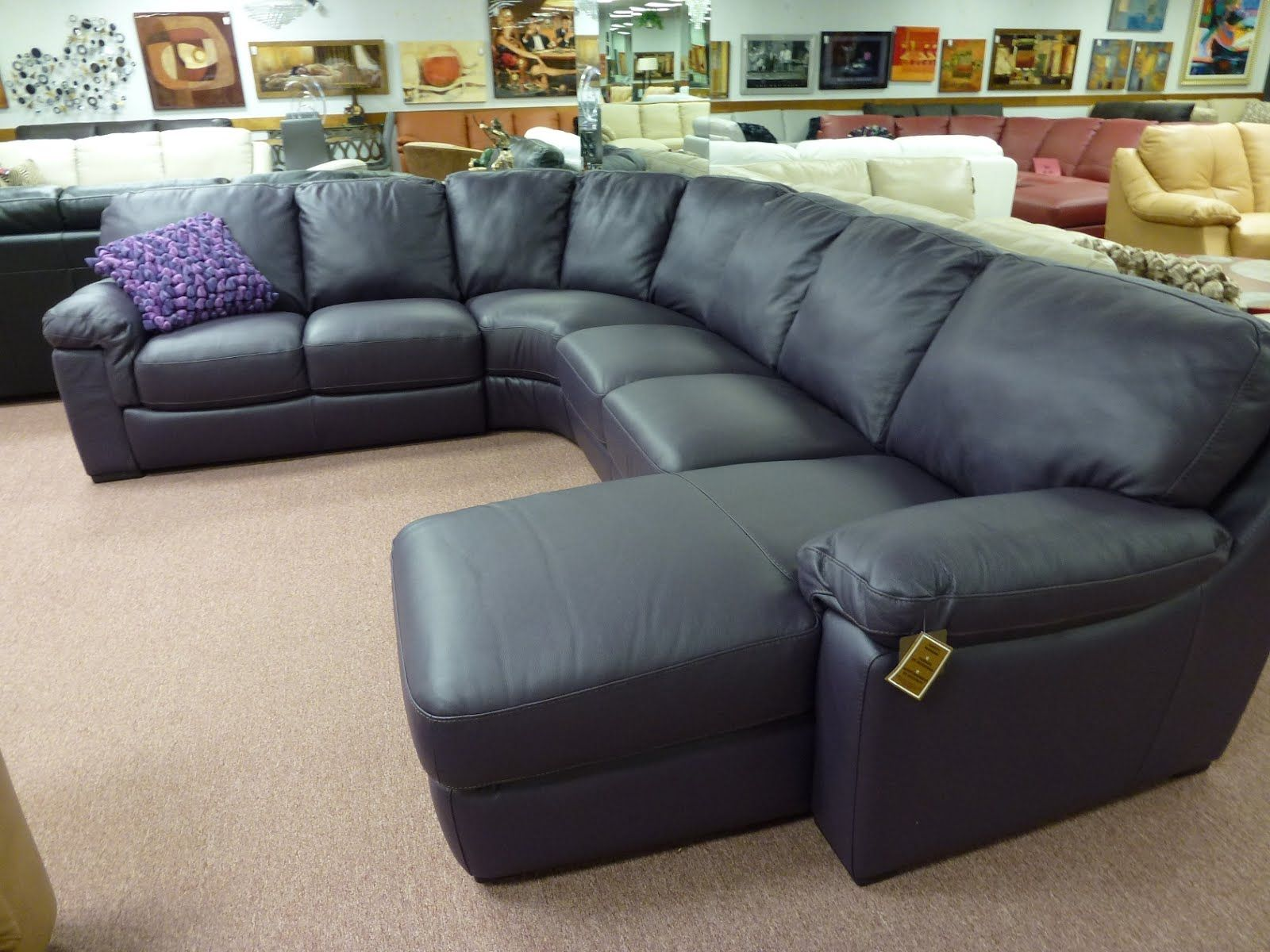 This Natuzzi Leather Sectional B594 Plum Eggplant Leather