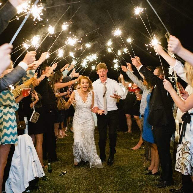 The guests lit sparklers, and the newlyweds left the reception by boat under the stars.